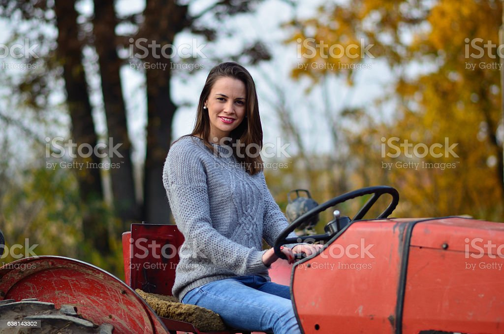 Girl on tractor stock photo