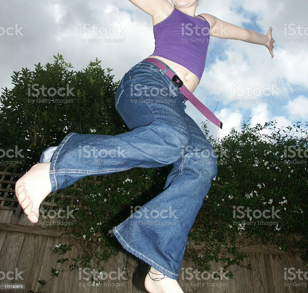 Girl on Trampoline royalty-free stock photo