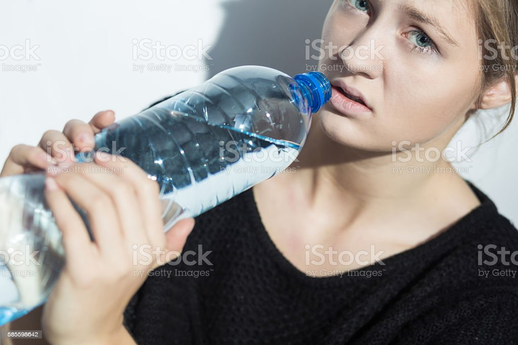 Girl on water diet stock photo