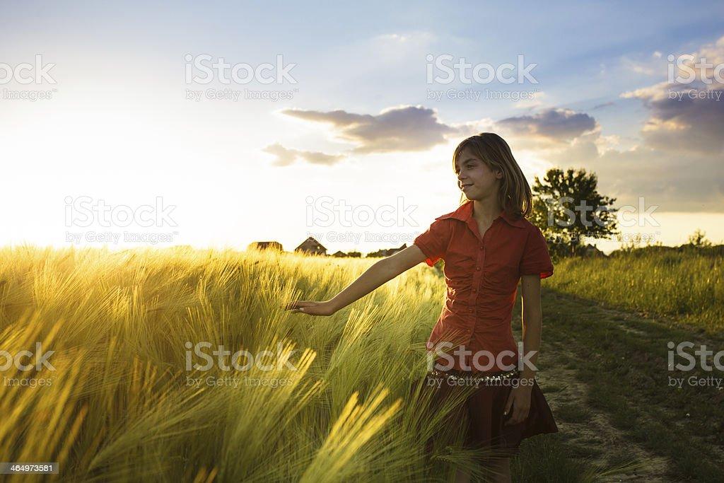 Girl on wheat fieald stock photo