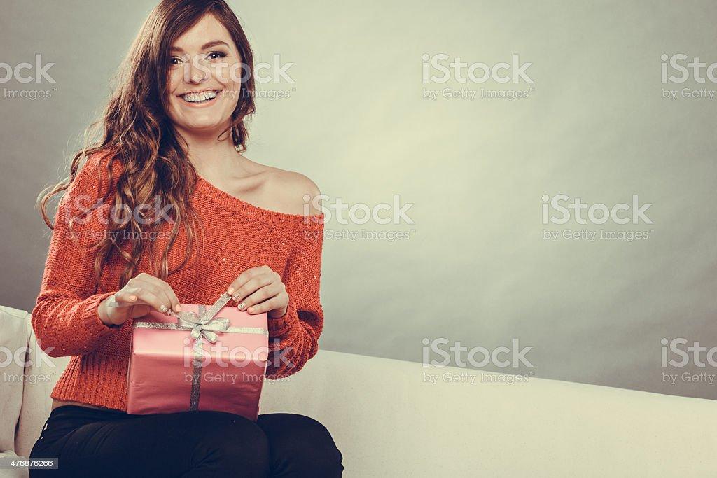 girl opening present pink gift box stock photo