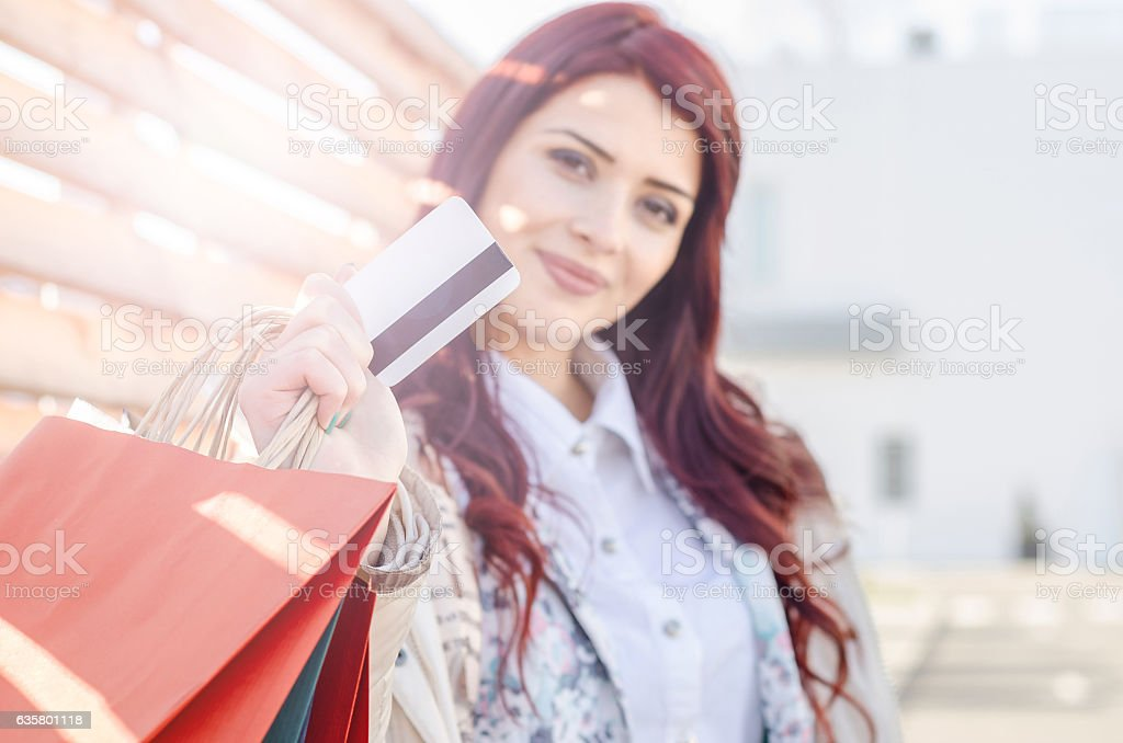 girl or business woman standing on the street with card stock photo