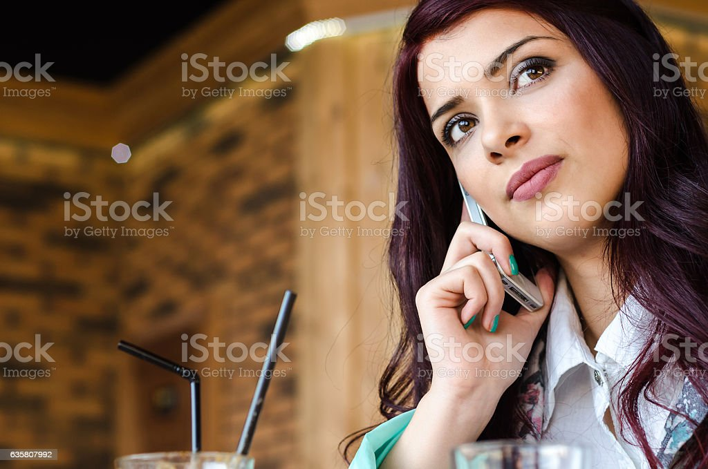 girl or business woman talking on the phone stock photo