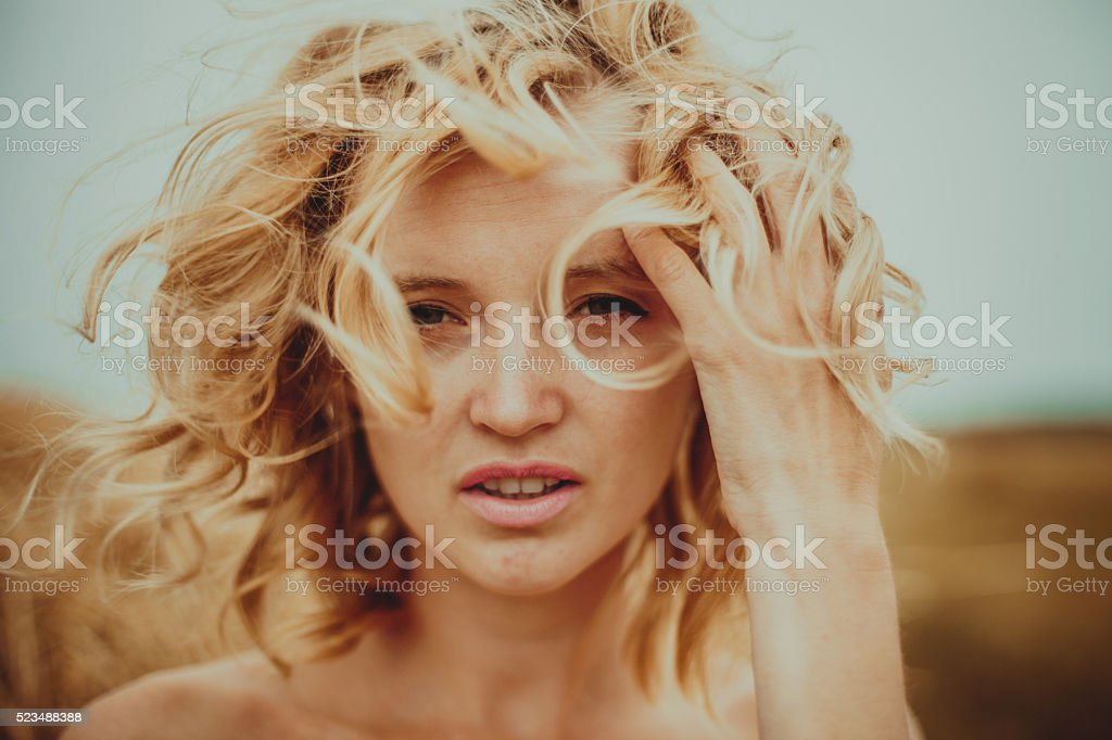 Girl Outdoors. Long Hair Blonde in the Wind. stock photo