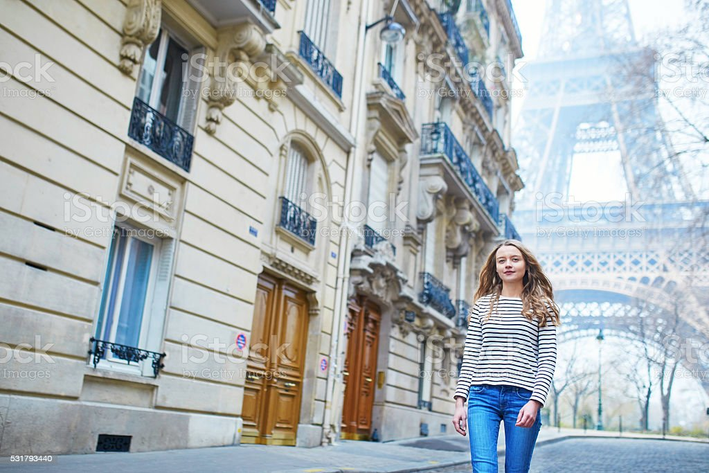 Girl outdoors near the Eiffel tower, in Paris stock photo