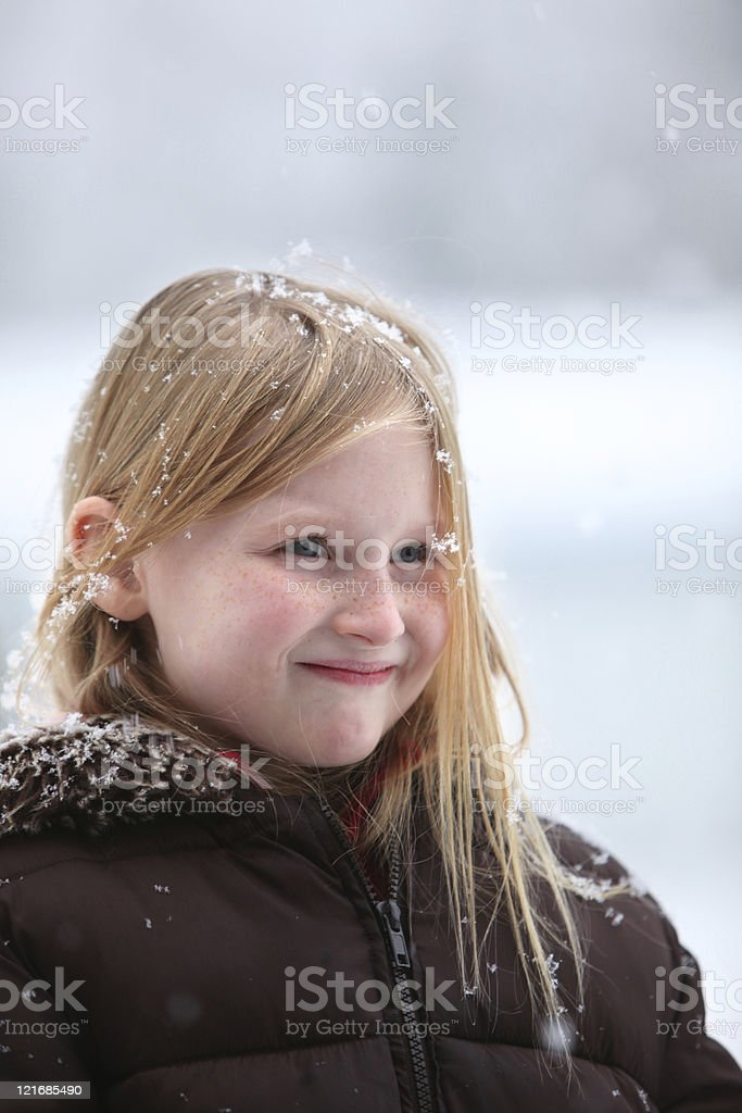 girl outside in the falling snow stock photo