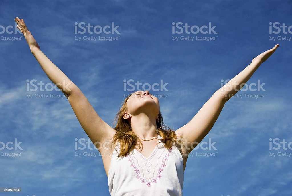 Girl over blue sky royalty-free stock photo
