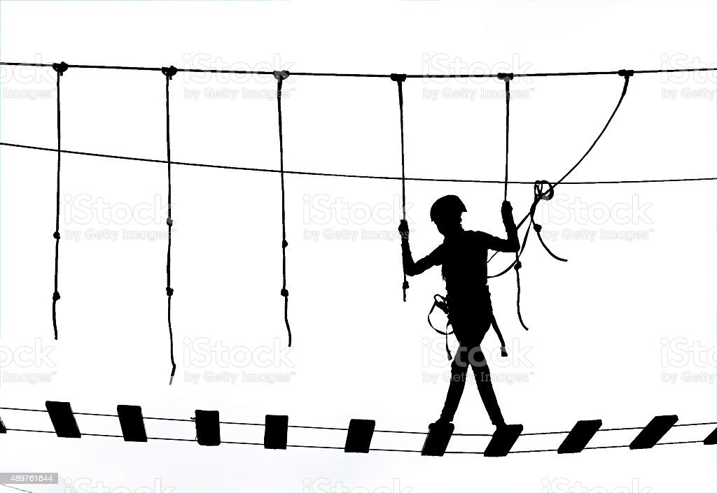 girl overcomes obstacles in the rope park stock photo