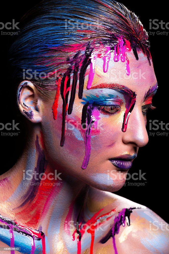 Girl painted different colors stock photo