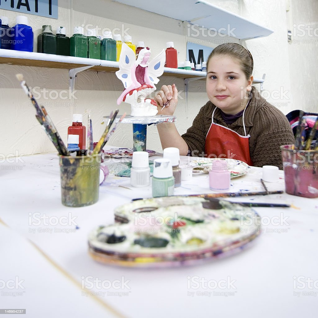 Girl painting ceramic fairy stock photo