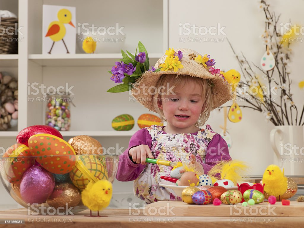 Girl Painting Eggs stock photo