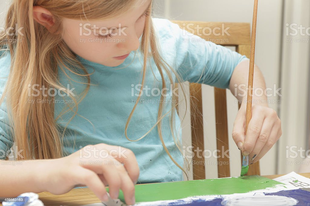 Girl painting on canvas stock photo