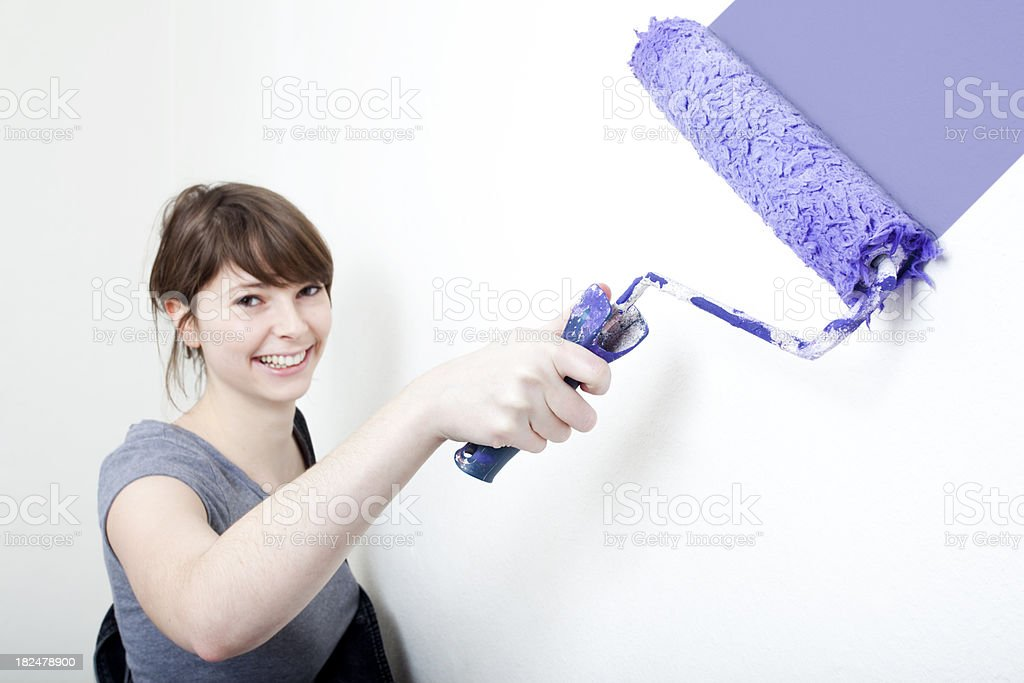 Girl Painting Wall royalty-free stock photo