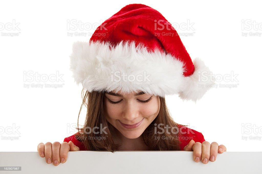Girl peeking behind noticeboard stock photo