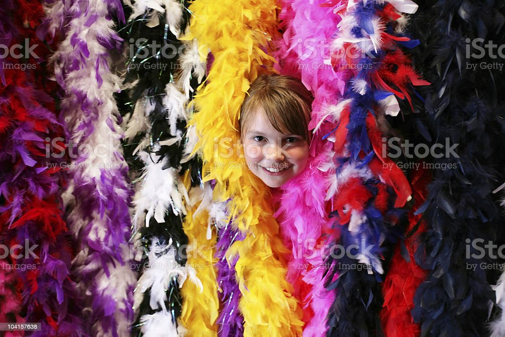 Girl Peeking out of Feather Boas royalty-free stock photo