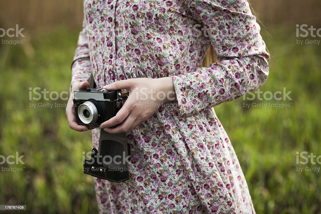 girl photographer is walking on the meadow royalty-free stock photo