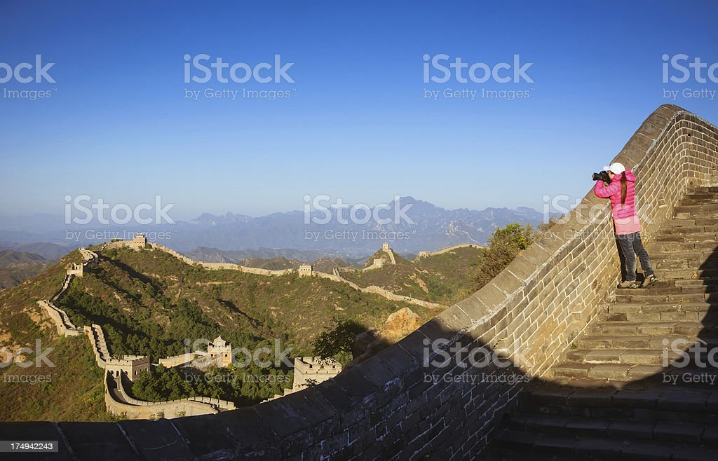 Girl photographer take photos on the Great Wall royalty-free stock photo