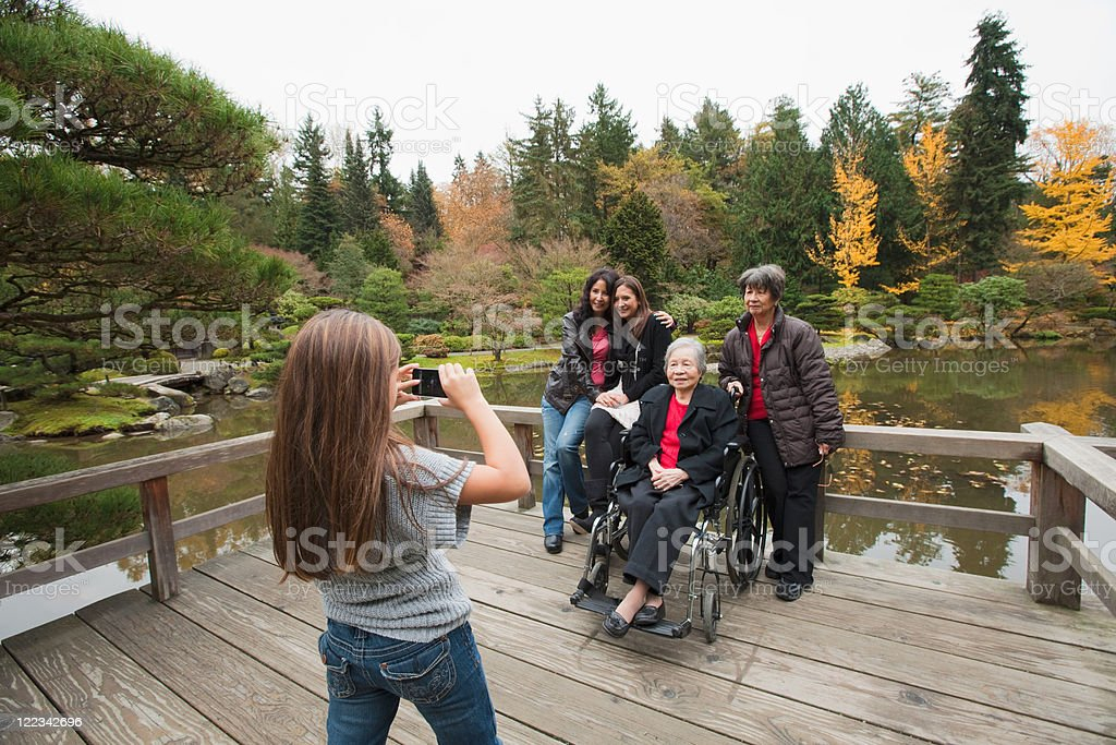 Girl photographing multi generation family stock photo