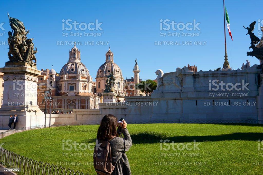 Girl Photographing Palazzo Valentini Domus stock photo