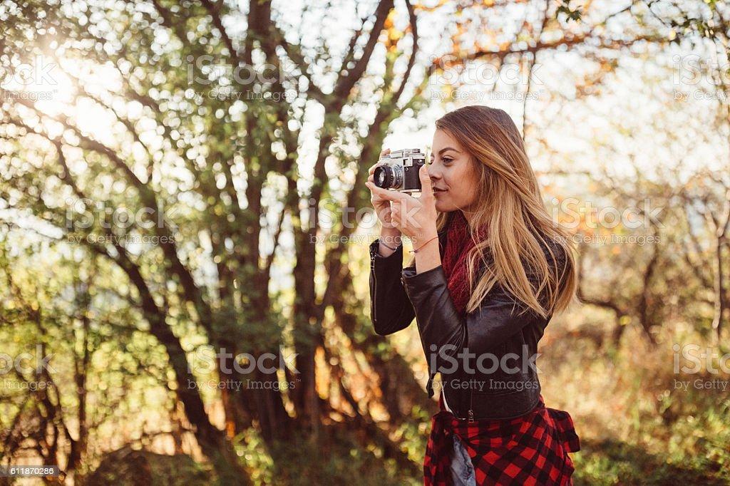 Girl photographing the autumn season stock photo