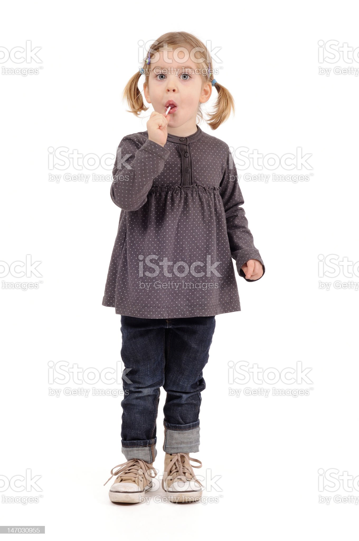 girl pigtails lollipop royalty-free stock photo