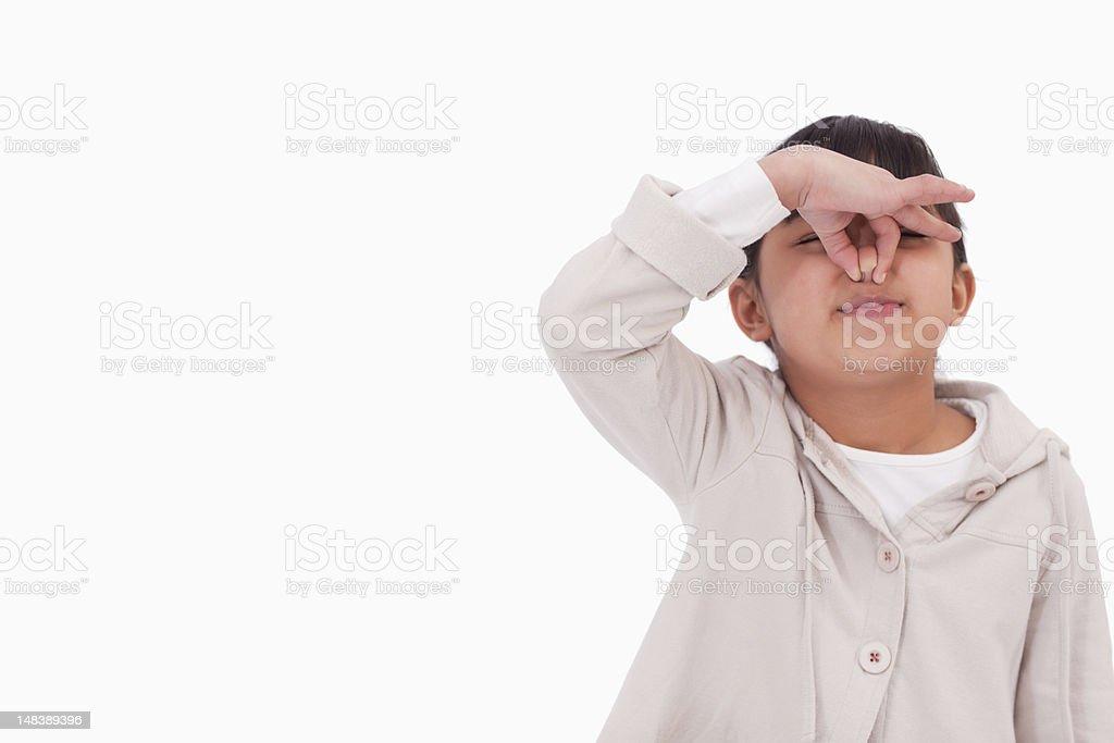 Girl pinching her nose stock photo