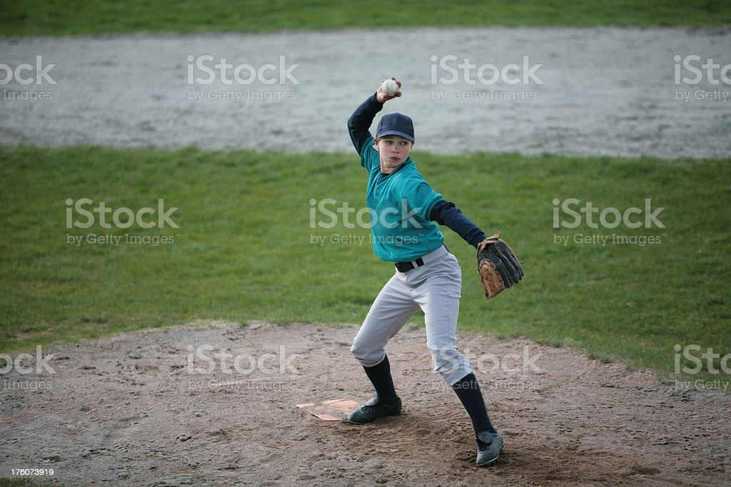 Girl Pitches Baseball in  Game royalty-free stock photo
