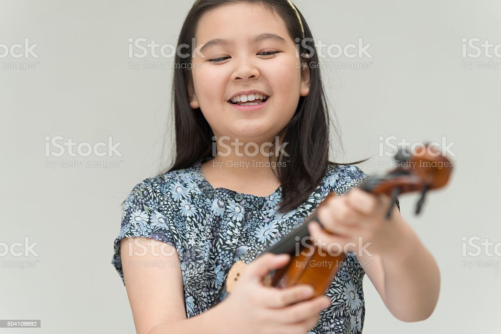 Girl Pizz Violin Strings stock photo