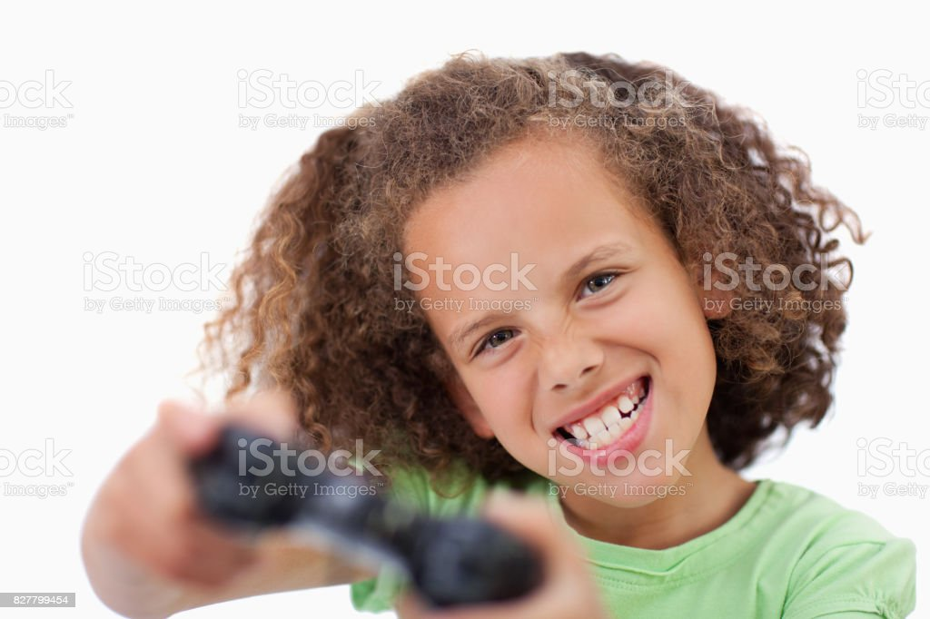 Girl playing a video game stock photo