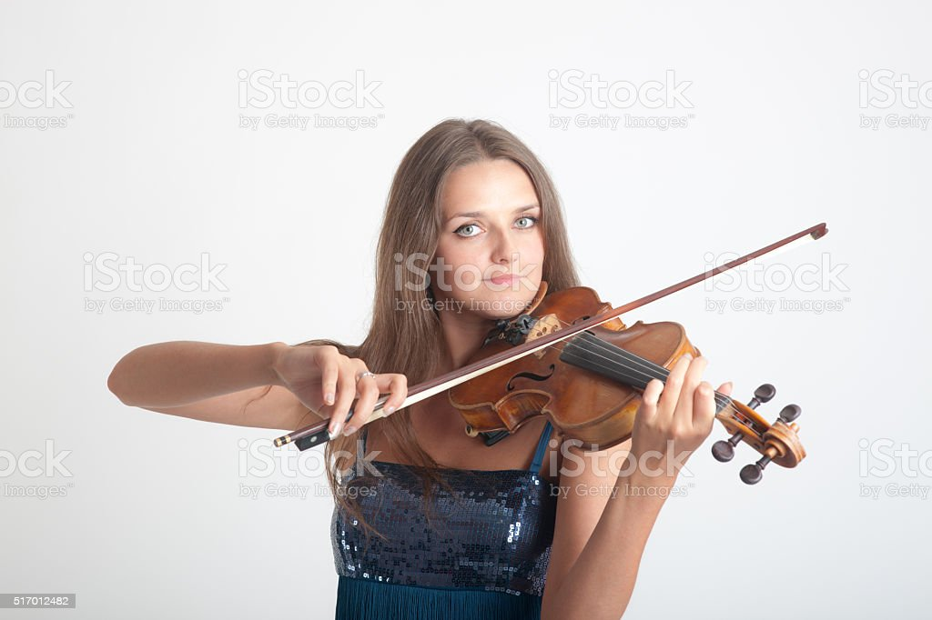 girl playing a violin stock photo