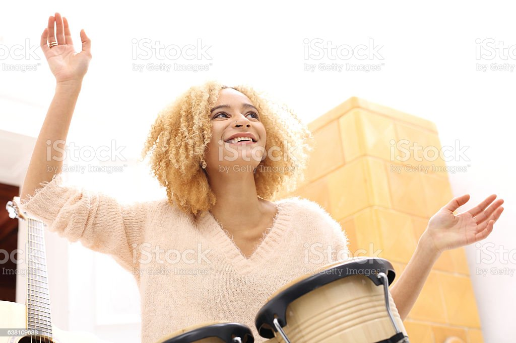 Girl playing bongo drums, small drums. stock photo