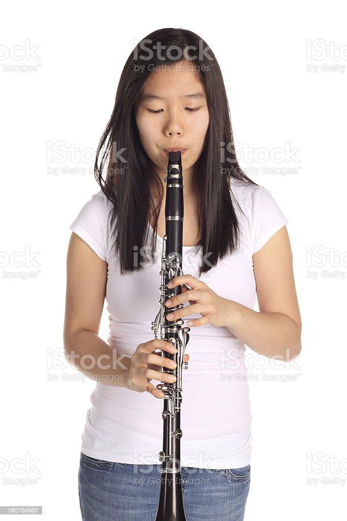 Girl playing clarinet stock photo