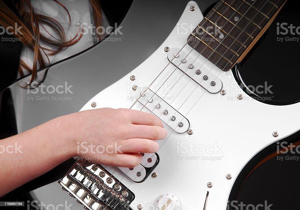 Girl Playing Electric Guitar stock photo