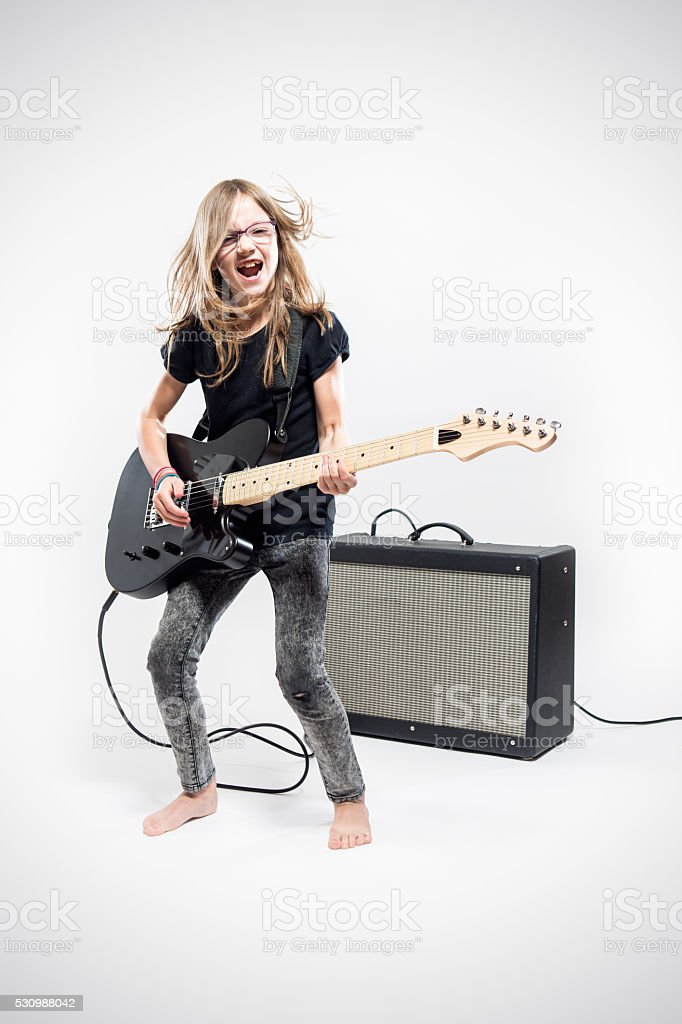 Girl Playing Electric Guitar stock photo