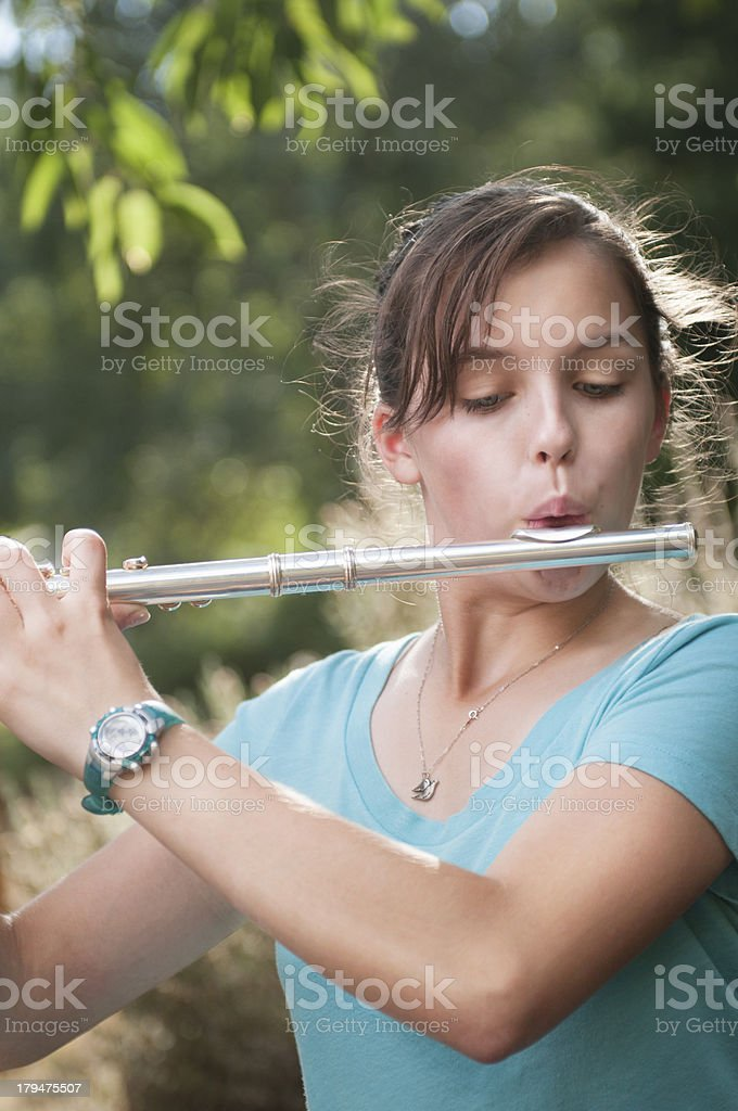 Girl Playing Flute in Garden royalty-free stock photo