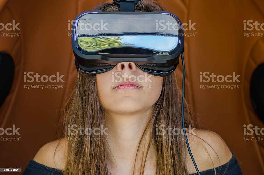 Girl playing game in virtual reality glasses stock photo