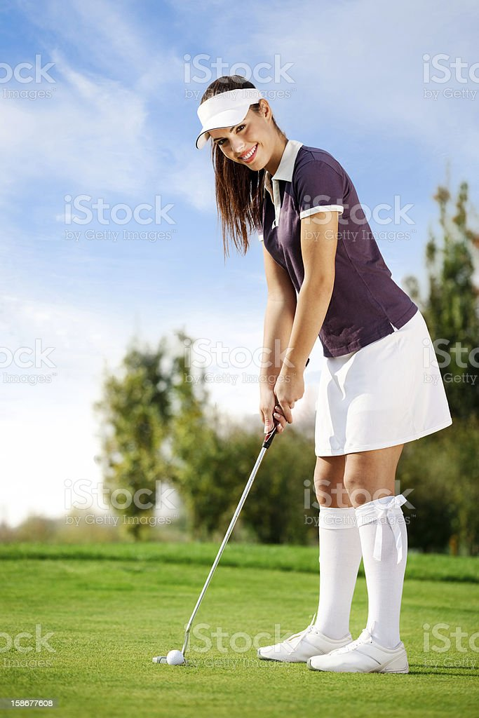 Girl playing golf royalty-free stock photo