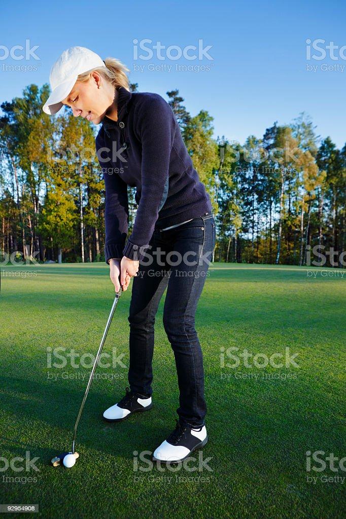 Girl playing golf royalty-free stock photo