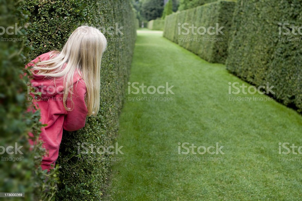 Girl Playing Hide and Seek royalty-free stock photo