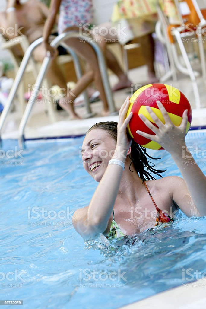 girl playing in a water-pool royalty-free stock photo