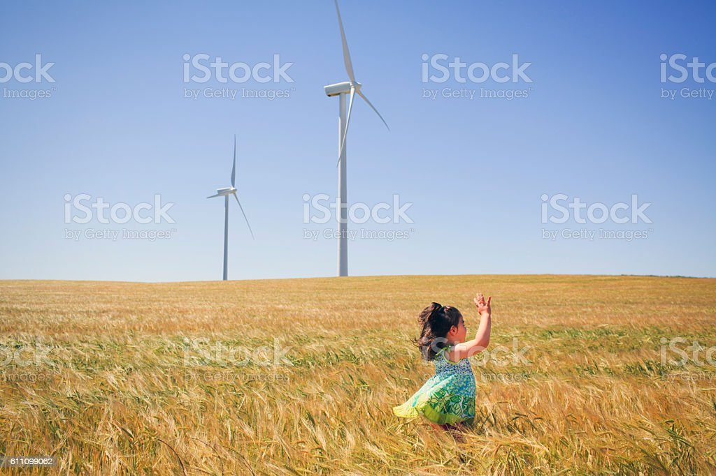 Girl playing in cereal field stock photo