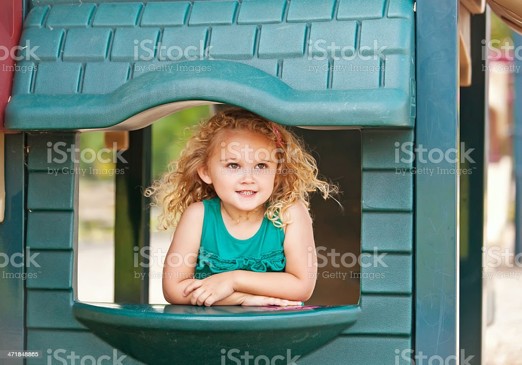 Girl Playing in House at Playground royalty-free stock photo