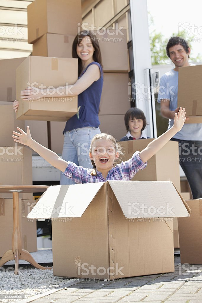 Girl playing in moving box royalty-free stock photo