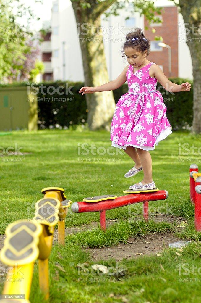 Girl (6-7) Playing In Playground stock photo