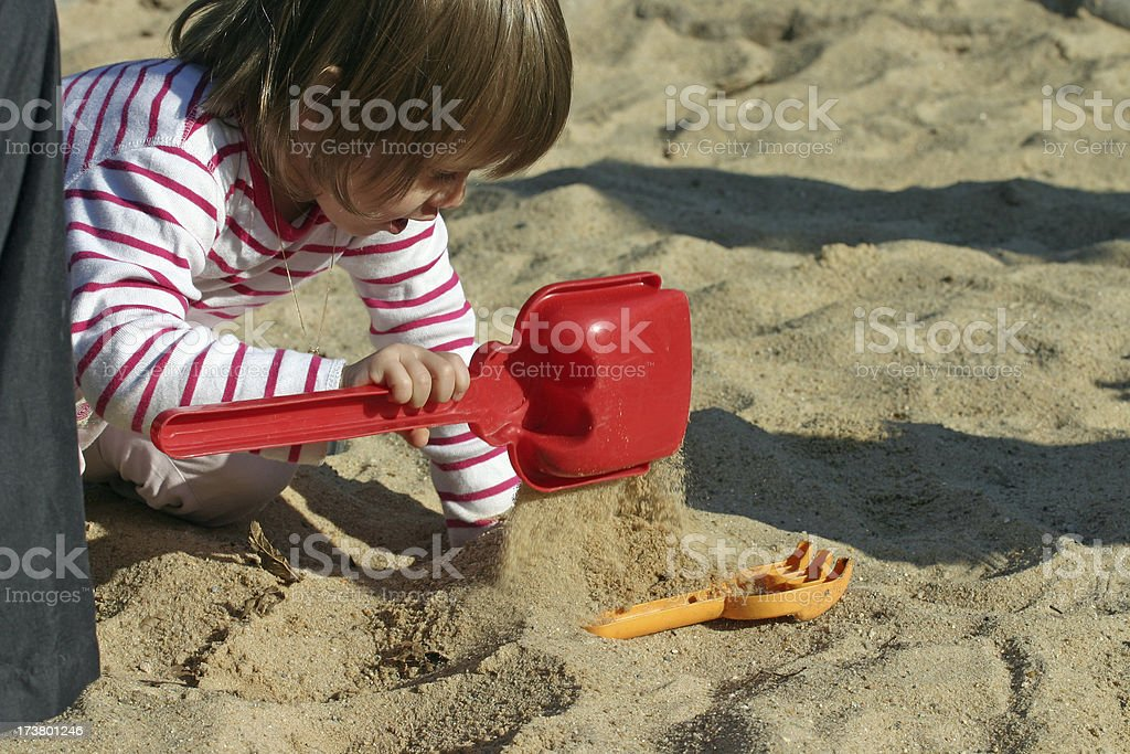 Girl playing in sand box royalty-free stock photo