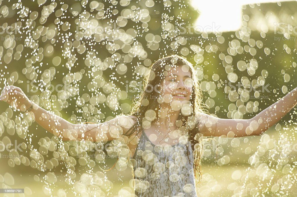 Girl playing in sprinkler royalty-free stock photo