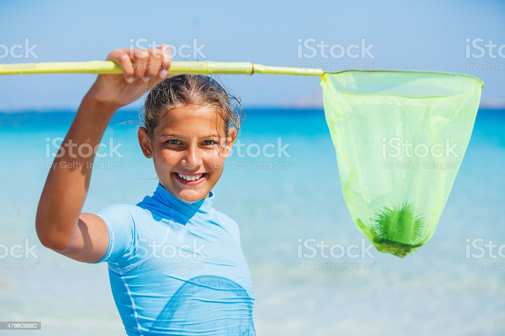 Girl playing in the sea stock photo