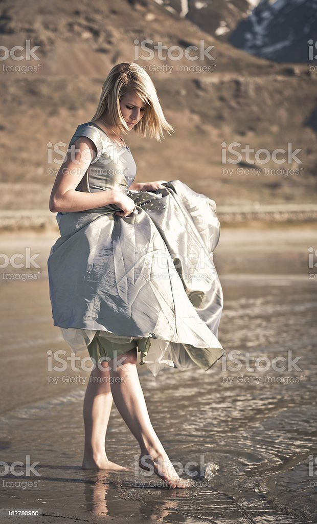 Girl playing in water royalty-free stock photo