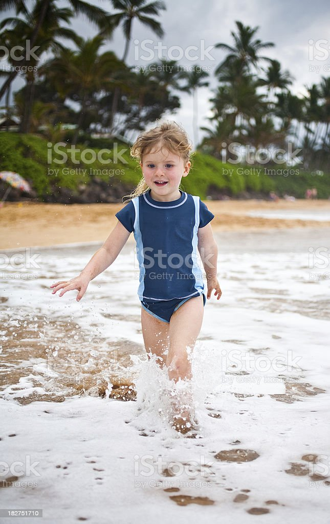 girl playing in waves royalty-free stock photo