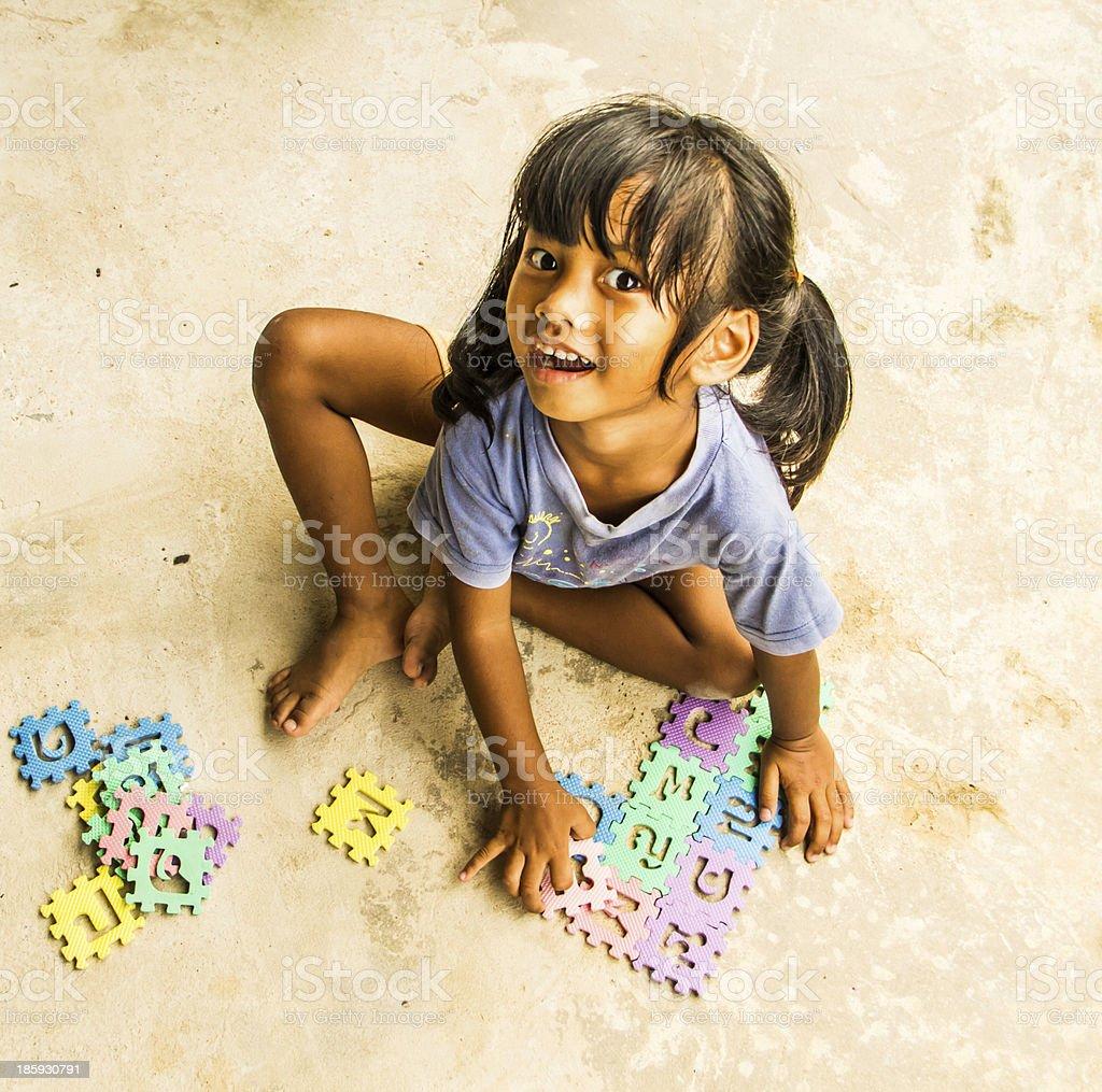Girl playing jigsaw royalty-free stock photo